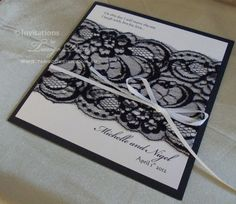 Black lace wedding invitation, with black base card and white cards stuck. Vintage, elegant, or gothic themes