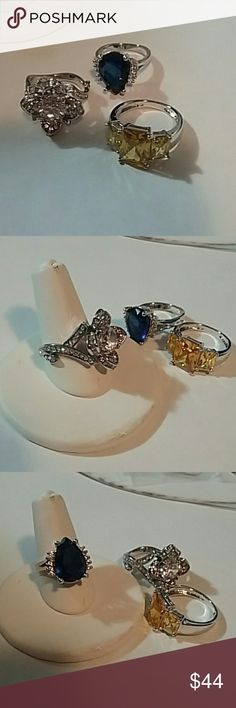 ON SALE 3 PRETTY SILVER RINGS For sale this lot of silver rings size 6. Blue, clear and champagne.  Please ask any questions before you buy for better service thank you. Jewelry Rings