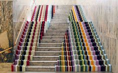 Designer Stuart Haygarth has installed picture-frame offcuts in stripes either side of a marble staircase at the Victoria & Albert Museum for the London Design Festival, 2010.