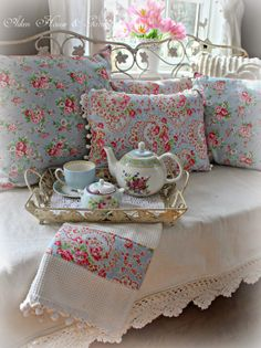 Aiken House & Gardens pretty linens on daybed tea party setting