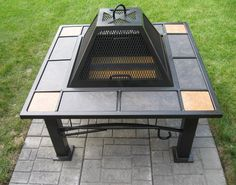 Stunning Outdoor Fire Pit Ideas Set On Black Iron Table With Slopping Cover And Green Grass In Backyard Gorgeous Fire Pit Ideas as Rustic Modern Home Exterior http://seekayem.com