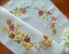Check out this item in my Etsy shop https://www.etsy.com/uk/listing/554473851/pretty-vintage-hand-embroidered-floral