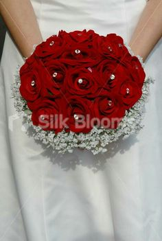 Not silk, diamond s in between roses not in center,diamonds in 3 not singular,no more than 5 diamond pins
