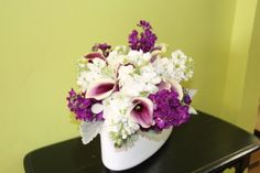Bridal bouquet of picasso miniature calla lilies, purple stock, white stock, white dendrobium orchids and dusty miller by Beautiful Blooms by Jen.
