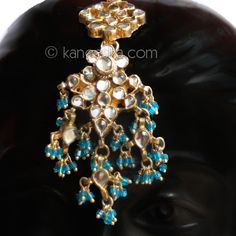 Turquoise Kundan Headpiece (Tikka) Beautiful floral shape tikka is made in kundan, attached to a golden string and finished with turquoise hanging beads, which is clasped to the hair. #KundanHeadpieceTikka #MaangTikkaDesigns
