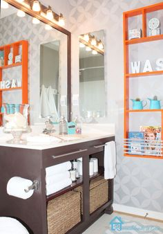 Bathroom orange and aqua. love the color scheme and the stencil and the vanity.