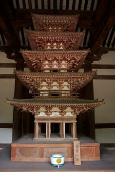 "This five-storied pagoda designated as a National Treasure is housed in the Saikondo or ""Western Main Hall"" of the Kairyuo-ji Temple in Nara-city."