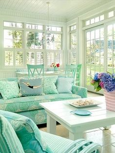 Lots of natural light with washed-out whites and punches of soft blues always seems to evoke a beachy ambiance...