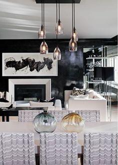Sleek & masculine living & dinning room. Love the dinning room chairs.