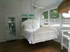 A screened-in porch and a hanging bed.