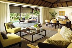 The expansive indoor and outdoor spaces of each Private Residence Villa at Four Seasons Resort Mauritius at Anahita feature island-inspired décor, including natural wood and stone accents and contemporary tropical furnishings
