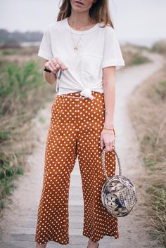 Jess Ann Kirby styles a boyfriend tee with Faithfull wide leg polka dot pants from Anthropologie Classy Outfits, Chic Outfits, Summer Outfits, Fashion Outfits, Fashion Tips, Polka Dot Pants, Polka Dots, Trouser Outfits, Thrift Fashion