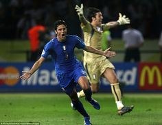 Italy's Fabio Grosso celebrates after scoring the winning penalty in the 2006 World Cup fi...