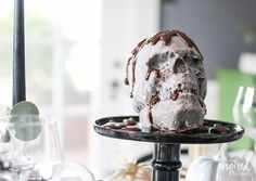 In need of a delicious and spooky Halloween dessert recipes? Then try this Chocolate Skull Cake from Inspired by Charm!