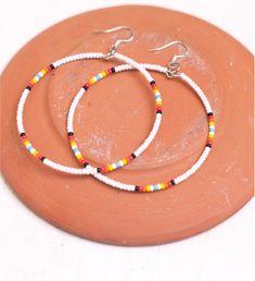 white seed bead hoop earrings by heidiroland on Etsy, $21.00