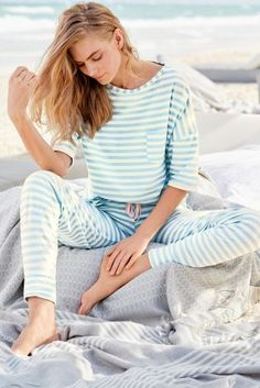 Add a bit of luxury to your nights in this summer with our blue stripe pyjama set.