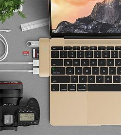 Satechi Type-C Hub for #macbook -- Here's a way to improve that 1-port 12-inch Retina MacBook. Satechi's compact Type-C Hub Adapter plugs into the side of the MacBook, adding three USB 3.0 Type-A ports, a Micro SD card slot, and an SD card slot. It's available in gunmetal, silver, and gold to match each shade of your Macbook.