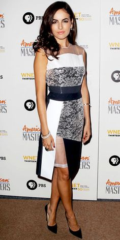 in a modern Preen dress that she styled with silver David Yurman jewelry and patent leather Jimmy Choo pumps.