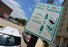 As reverse-angle parking suddenly joins Peoria's Traffic Fad of the Month Club, we have two possibilities.