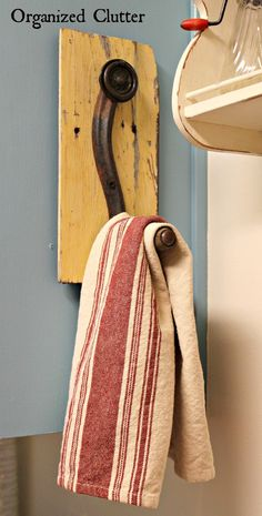 Use an old crank as a hook for your towels or what ever else floats your boat. Genius!.......D.