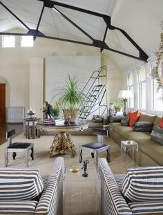 Like the pop of graphics the pair of striped chairs gives this room.