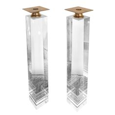 Pair of lucite & brass candle holders by Karl Springer  USA  1970s  A Stunning pair of Karl Springer lucite candle holders with brass tops. These came from an estate in Indian Wells designed by Steven Chase.