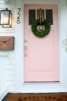Painted Front Door Tips and our new PINK Door - Nesting With GracePainting Tips for Front Door- Pink Front Door in Coral PerfectionSubtle & Sophisticated Pink Paint Colors For Interiors! Coral Front Doors, Front Door Paint Colors, Painted Front Doors, Front Door Decor, Front Porch, Front Door Painting, Coral Door, House Paint Exterior, Exterior House Colors