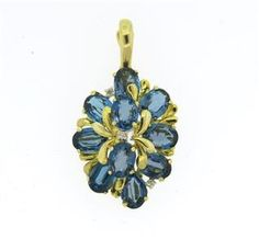 14k Gold London Blue Topaz Diamond Pendant Available @ hamptonauction.com at the Fine Jewelry Watches Coins and Collectibles Auction on January 26, 2015! Come preview our catalog!