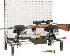 "Hyskore® Cleaning and Maintenance Station  Multifunctional platform fits any-length gun and can be rotated and locked into multiple positions for easy, secure cleaning. Two self-centering vises point muzzle up or down so chemicals run away from the action and trigger. Includes a pegboard panel and shelf for hanging, cleaning and storage.  Dimensions: 30""H x 32""W X 16""D."