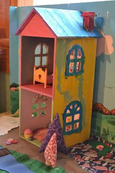 A pair of very bright, kiddly Michaels CD dollhouses.