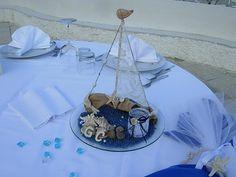 creazione realizzata su tronco  a forma di barca a vela con pizzo