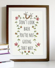 "A4 quote artwork print: ""Don't look back, you're not going that way"" / inspirational art print / art print / quote art / wall art. $15.00, via Etsy."