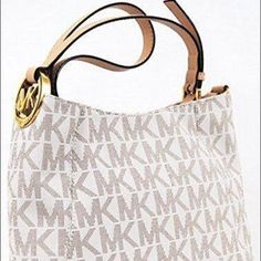 Just in! MK Fulton Crossbody Bag NWT  Vanilla pvc with tan pin dot signature print. Polished gold tone hardware, flat bottom. Rear magnetic snap closure compartment, zip top closure. Adjustable tan leather handle with gold tone MK medallion accent. Measures 12 inches long, 9 inches in height, and 4 inches depth. Leather strap 21 inch drop. Great summer bag! Michael Kors Bags Crossbody Bags