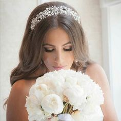 Beautiful bride Faina looking so classic and elegant in @bridalstyleboutique's custom pearl and crystal headpiece. Bridal hair by @senadakxo and makeup by @_goldengirl. Photo by @greylinephotography. #BridalStylesBoutique #bridalhair #bridalmakeup #makeup
