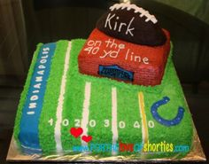 Colts football 40th birthday cake featuring football field, Conseco fieldhouse, and a football; chocolate bottom layer and football layer, vanilla middle layer, buttercream frosting, Satin Ice accents, buttercream and gel piping. @fortheloveofshorties.com