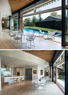 The entryway of this modern house leads to a dining area with oversized 8-ft by 10-ft sliding glass panel doors that open directly to the pool, creating a seamless indoor-outdoor environment. #ModernHouse #GlassDoors #SwimmingPool