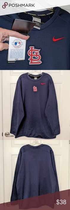"🆕 NIKE MLB St. Louis Cardinals Pull-over - XXL DESCRIPTION 🆕 NIKE MLB Genuine Merchandise Navy St. Louis Cardinals Waffle Fleece Pull-over - XXL  🎄🎀 GREAT FOR GIFT GIVING! 🎀🎄  FEATURES * Major League Baseball (MLB) Genuine Merchandise * Embroidered St. Louis Cardinals logo * Navy * Pull-over  * Waffle fleece * 95% Polyester/5% Spandex  MEASUREMENTS * 26.5"" Pit to pit * 31"" Neck to hem  NOTES * NEW WITH TAGS Nike Shirts Sweatshirts & Hoodies"