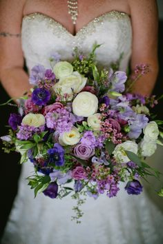 Loose floral bouquet in various shades of purple.  Photo: Corey Fox Photography