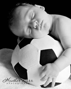 Newborn soccer picture. This will clearly be happening one day. newborn photos, sports themed newborn photos #baby #photography #newborn