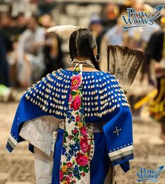 Modern Sioux woman dances in the Women's Cloth category at Hunting Moon powwow 2013.