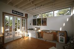 Little House on the Trailer: Salzman's studio includes high windows which maximize light and wall space for hanging pieces.