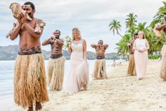 Pink salmon dresses for the bride and the bridemaid Fijian Warrior surrounding the bride while she enters the ceremony