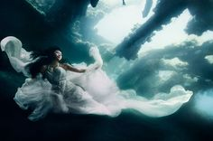 Fashion/art photoshoot under 25m of water by Benjamin Von Wong with experienced divers as models for Ali Charisma dresses