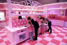 The pink kitchen is pictured with cupcakes in the Barbie Dreamhouse Experience near Alexanderplatz square in Berlin, Germany, Thursday May 16, 2013. The 2,500 square meter Barbie Dreamhouse Experience..