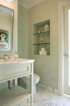 I love this soft -relaxing shade of green. It has a spa-like quality. The inset next to the set back toilet draws your eye away from the toilet.