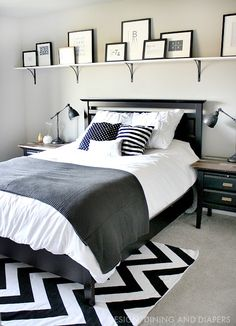 Bold Shelf Above Bed with rustic modern black and white decor
