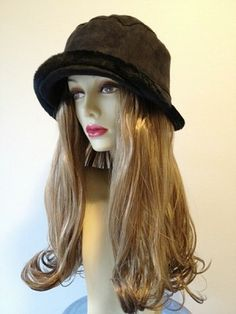"Black Faux-suede #Bucket Hat  Hair Length: 14"" Straight Hair with Curled Ends Hair Color Pictured: Light Brown with highlights  (3 Colors Available- See dropdown menu) Kenakalon Synthetic Hair Fiber- highest quality synthetic fiber available on the market."