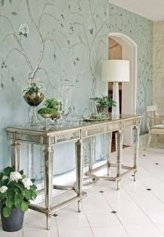 How to use mirrored furniture in your home - mirrored furniture and greenery.jpg