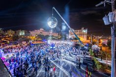 <p> A disco ball measuring 20 feet in diameter presided over the launch event for the real estate development Paramount...