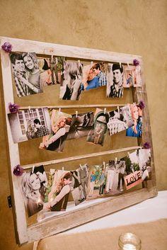 Decoração com fotos dos noivos.